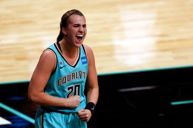 New York Liberty guard Sabrina Ionescu (20) reacts after making the game winning basket against the Indiana Fever during a WNBA basketball game, Friday, May 14, 2021, in New York.
