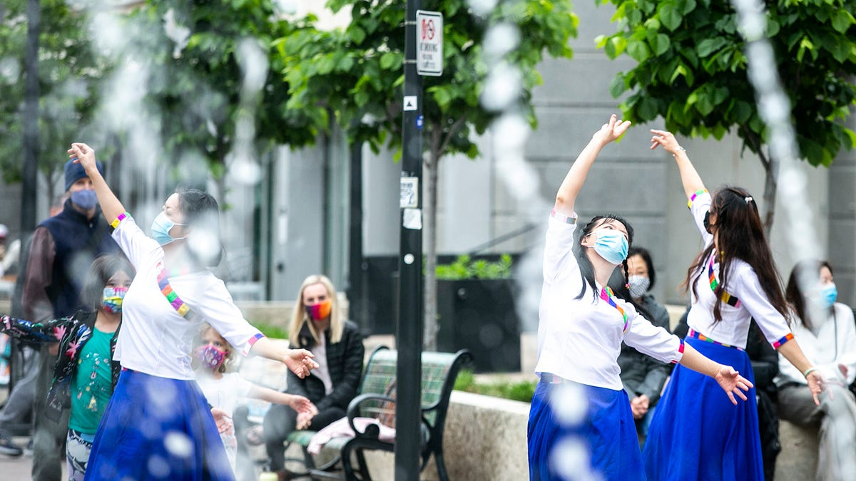Photos: Iowa City community members participate in dance party on the pedestrian mall