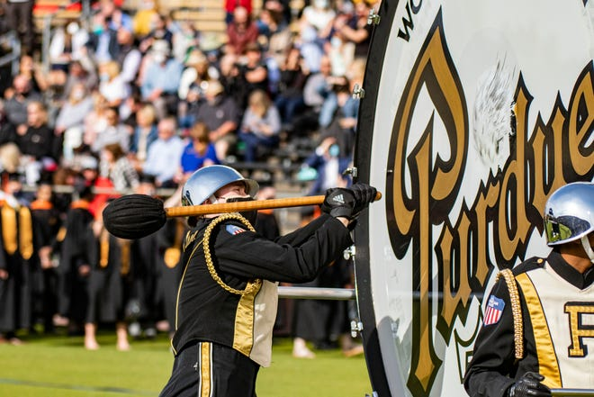 A drummer hits a drum before Purdue University's 2021 Spring Commencement on May 15, 2021, in Ross-Ade Stadium. Purdue students and faculty celebrated the first outdoor commencement in the university's history.