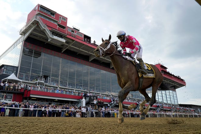 Flavien Prat atop Rombauer wins the 146th Preakness Stakes horse race at Pimlico Race Course, Saturday, May 15, 2021, in Baltimore. (AP Photo/Julio Cortez)