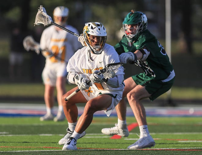 Action during the St.X-Trinity state lacrosse championship Friday night at Christian Academy of Louisville. May 14, 2021