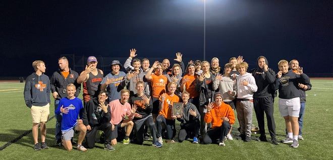 The Ashland High boys track and field team poses for a photo after winning its fifth consecutive Ohio Cardinal Conference title during the league meet on Friday at Ashland University's Ferguson Field.
