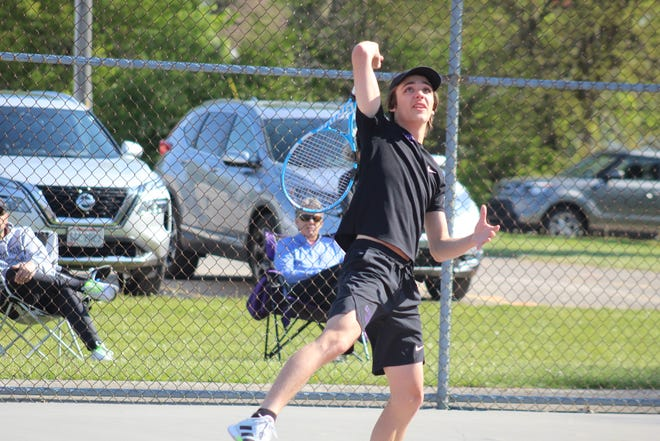 Lexington's Ross Drlik watches his shot during the Division II Shelby Sectional last Saturday. Drlik and his doubles partner Ryan Mecurio advanced to the district finals on Wednesday, qualifying for state in the process.