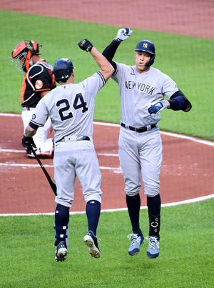 New York Yankees outfielder Aaron Judge (99) is congratulated by designated hitter Gary Sanchez (24) after hitting a home run in the first inning against the Baltimore Orioles at Oriole Park at Camden Yards.