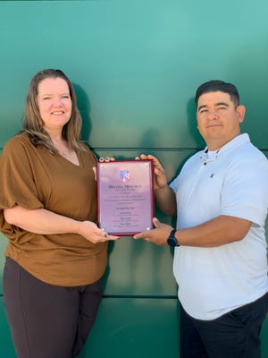 Melissa Meechan, a longtime youth wrestling coach and current Vice President of the Four Corners Wrestling Association, seen here with FCWA Chair Jaime Morales, was named the New Mexico AAU Person of the Year.