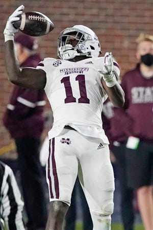 Mississippi State wide receiver Geor'quarius Spivey (11) catches a pass against Mississippi during the second half of an NCAA college football game, Saturday, Nov. 28, 2020, in Oxford, Miss. Mississippi won 31-24.