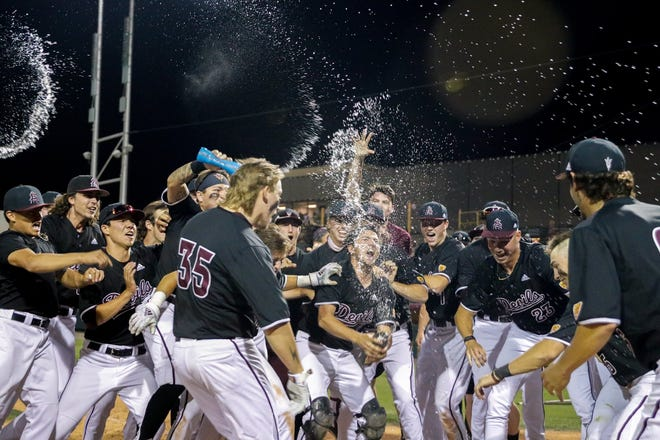 ASU freshman Ethan Long (35) celebrates with his teammates after hitting a walk off homer Friday night against Oregon State.