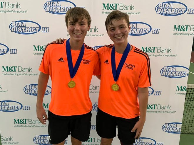 Palmyra twin brothers, from left, Tyler and Aidan Mahaffey proudly display their gold medals after capturing the District 3 3A doubles title two weeks ago at Hershey Racquet Club.