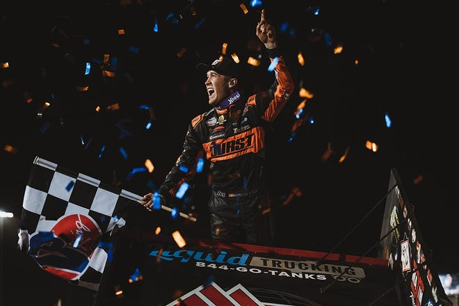 Carson Macedo celebrates after his Friday night World of Outlaws win at Williams Grove Speedway.