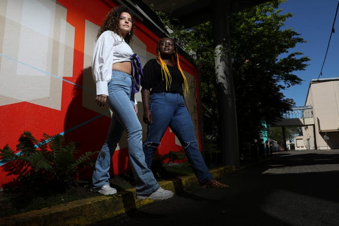 """Co-owners of Philanthropy Phabrics Sophia Cobb, left, and Kundai Kapurura, both South Salem High School graduates, started the business that """"upcycles"""" clothes and donates to causes they care about."""