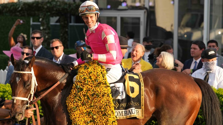 Jockey Flavien Prat and Rombauer celebrate in the Winners Circle after winning the 146th Preakness Stakes.