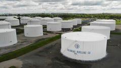 Colonial Pipeline storage tanks are seen in Woodbridge, N.J., on Monday, May 10, 2021.