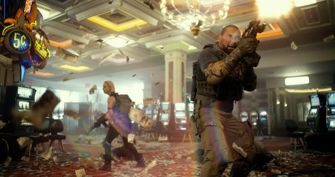 """Nora Arnezeder and Dave Bautista fight zombies who have taken over Las Vegas in Zack Snyder's """"Army of the Dead."""""""