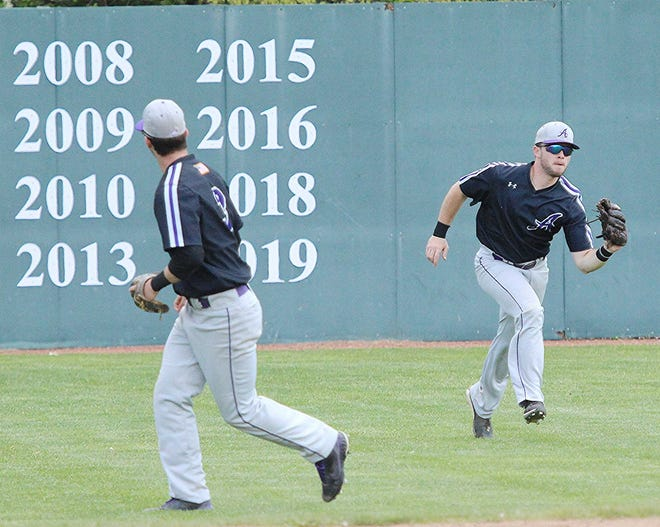Ashland's Dillan Smith makes a catch in the outfield against Saginaw Valley State Saturday at Donges Field.