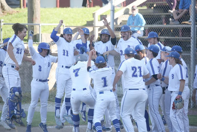 Boonville junior Jamesian McKee receives a warm welcome from his teammates after hitting a three-run home run in the first inning Thursday night against Marshall in the regular season finale at Twillman field in Harley park. The Pirates halted Marshall's 14 game win streak with a 10-1 victory. Boonville junior Jamesian McKee receives a warm welcome from his teammates after hitting a three-run home run in the first inning Thursday night against Marshall in the regular season finale at Twillman field in Harley park. The Pirates halted Marshall's 14 game win streak with a 10-1 victory.