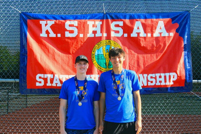 Drew Middleton (left) and Noah Allison (right) pose with their medals after placing fourth in the Class 4A state doubles tournament on Saturday, May 15 at the Tossover Tennis Center in Topeka, Kansas.