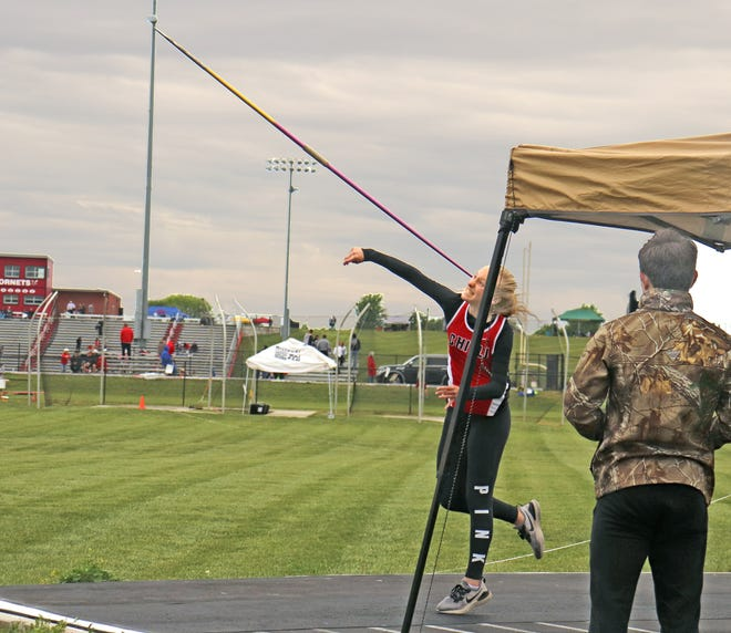 """A mere 11 days after eclipsing Jalynn Reeter's 4-years-old school record in the event with a throw of 103' during the Midland Empire Conference track-and-field Championships at home, sophomore Hope Helton of the Chillicothe High School Lady Hornets lets go of the spear on the way to sending it a record-shattering 113'11"""" (34.48 meters) on her last attempt in Saturday's Class 3 District 8 meet, also at Chillicothe's Jerry Litton Memorial Stadium II. The longest-ever throw by a CHS girl also carried Helton to the district title and a berth in the state-qualifying sectional meet this coming Saturday."""