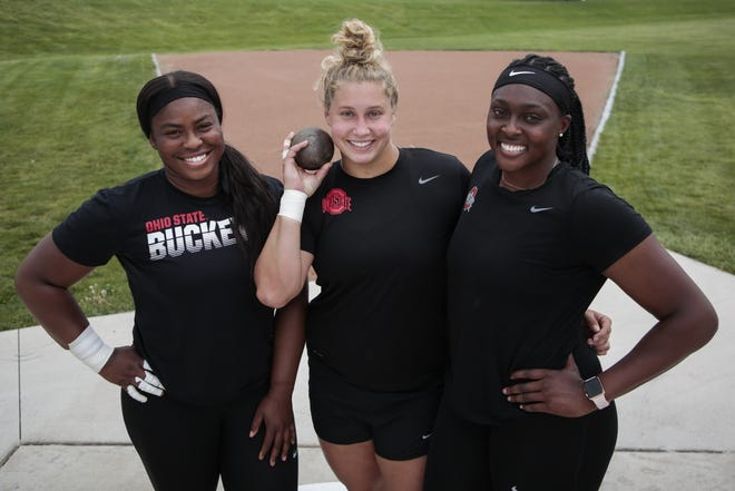 Ohio State throws specialists, from left, Divine Oladipo, Adelaide Aquilla and Sade Olatoye pose for a portrait earlier this month.
