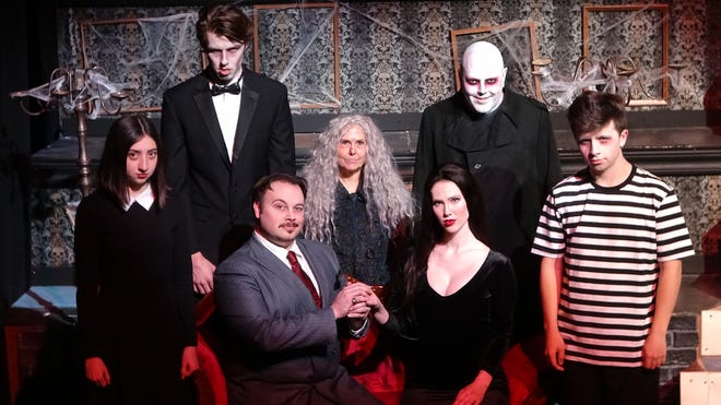 """From left: Avery Bank as Wednesday Addams, Ben Teitlebaum as Lurch, Jordan Stocksdale as Gomez, Linda Roth as Grandma, Tess Marshall as Morticia, Luke Bovenizer as Uncle Fester and Joe Gallagher as Pugsley in Columbus Immersive Theater's production of """"The Addams Family Quarantined Concert."""""""