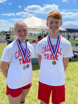 Caldwell eighth graders Gwyn Lori, left, and Ethan Crock pose with their medals earned at the OHSAA 7th-8th Grade State Track and Field Championships held Saturday in Hilliard.
