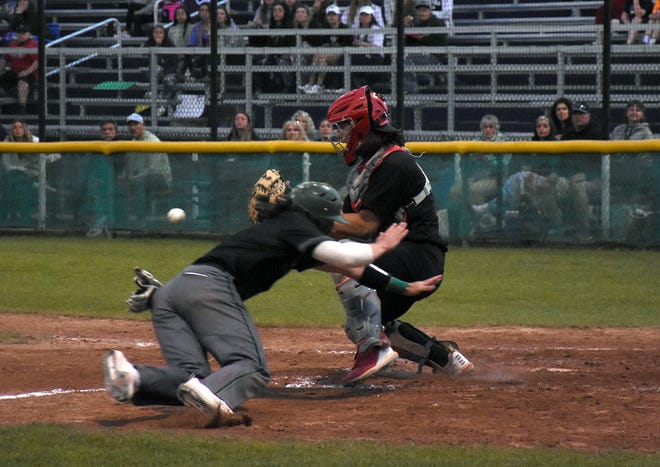 Herkimer College's Matt Tobin dives for home plate with Erie Community College catcher Cole Cote (right) waiting for a throw during the fourth inning of a Saturday elimination game at Veterans Memorial Park in Little Falls.