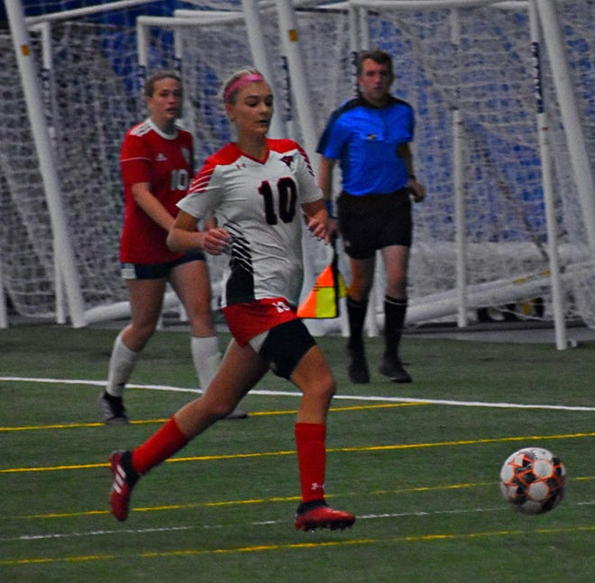 Southeastern Community College's Taylor Ackerman chases the soccer ball in the second half of Sunday's Region XI quarterfinal match at the FunCity Turf. SCC beat Scott Community College, 1-0, in two overtimes.