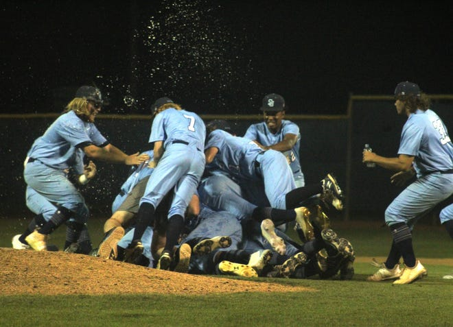 St. Johns Country Day players form a pile on the mound in celebration after defeating Tallahassee North Florida Christian to win the FHSAA Region 1-2A baseball final on May 15, 2021. [Clayton Freeman/Florida Times-Union]