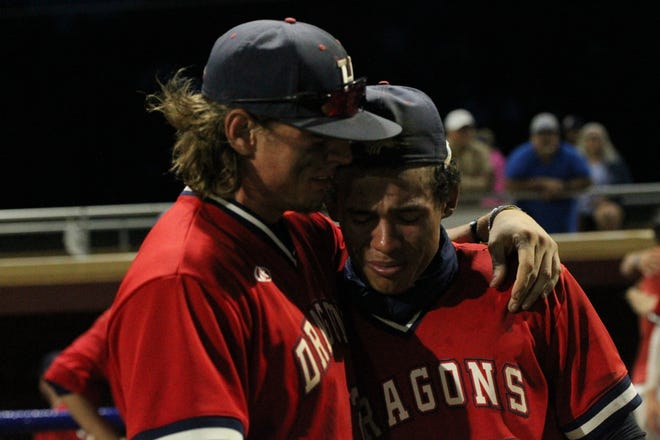 HCC's Jenner Steele (left) and Mason Lowe (right) embrace each other following the Blue Dragons' loss in the NJCAA Region VI sub-regional final to Colby at Hobart-Detter Field.