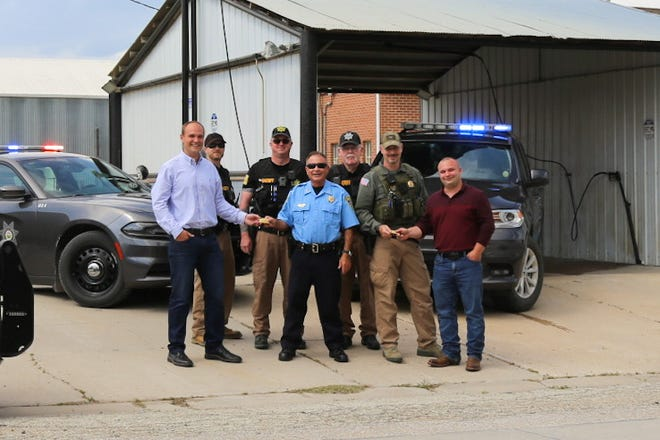 """Owners of the Canton Car Wash LLC., Dakota Nichols and Tom Kueser, presented the McPherson County Sheriff's Office and the Canton Police Department with free car washes in recognition of National Law Enforcement week.  """"We are happy to play a small part in giving back to the men and women who keep our communities safe"""", said Tom Kueser.  """"Sheriff Montagne and Chief Barnett are two of the best.  Thank you for all you do!"""""""