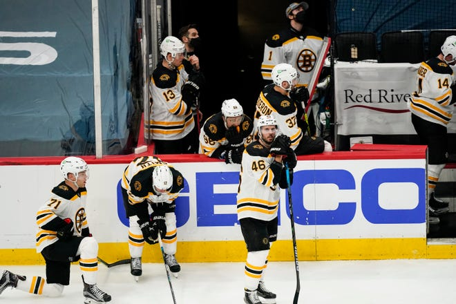 Boston Bruins center David Krejci (46) and others wait while a goal by Washington Capitals' Nic Dowd is reviewed during overtime of Game 1 in an NHL hockey Stanley Cup first-round playoff series on May 15, 2021, in Washington. The Capitals won 3-2.