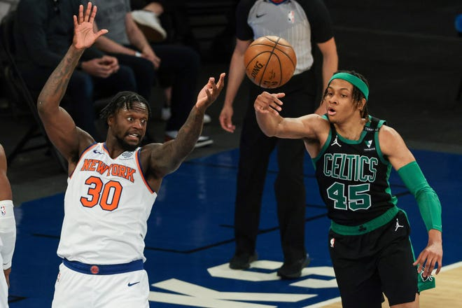 Boston Celtics guard Romeo Langford deflects the ball away from New York Knicks forward Julius Randle (left) during the second half of an NBA basketball game in New York, Sunday, May 16, 2021.