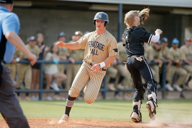 Heritage Hall's Jackson Jobe scores a run past Evan Anderson of Verdigris during a Class 4A baseball state tournament championship game in Shawnee on May 15.