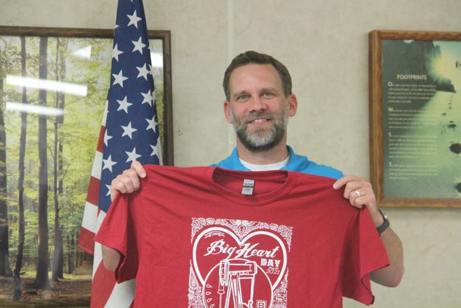 Pastor Jason Byers of Barnsdall is shown with a Big Heart Day T-shirt. Byers and his wife, Brenda, will be marshals for the parade held as an element of the town's annual Memorial Day weekend celebration. To buy a T-shirt, contact the Barnsdall Chamber of Commerce.