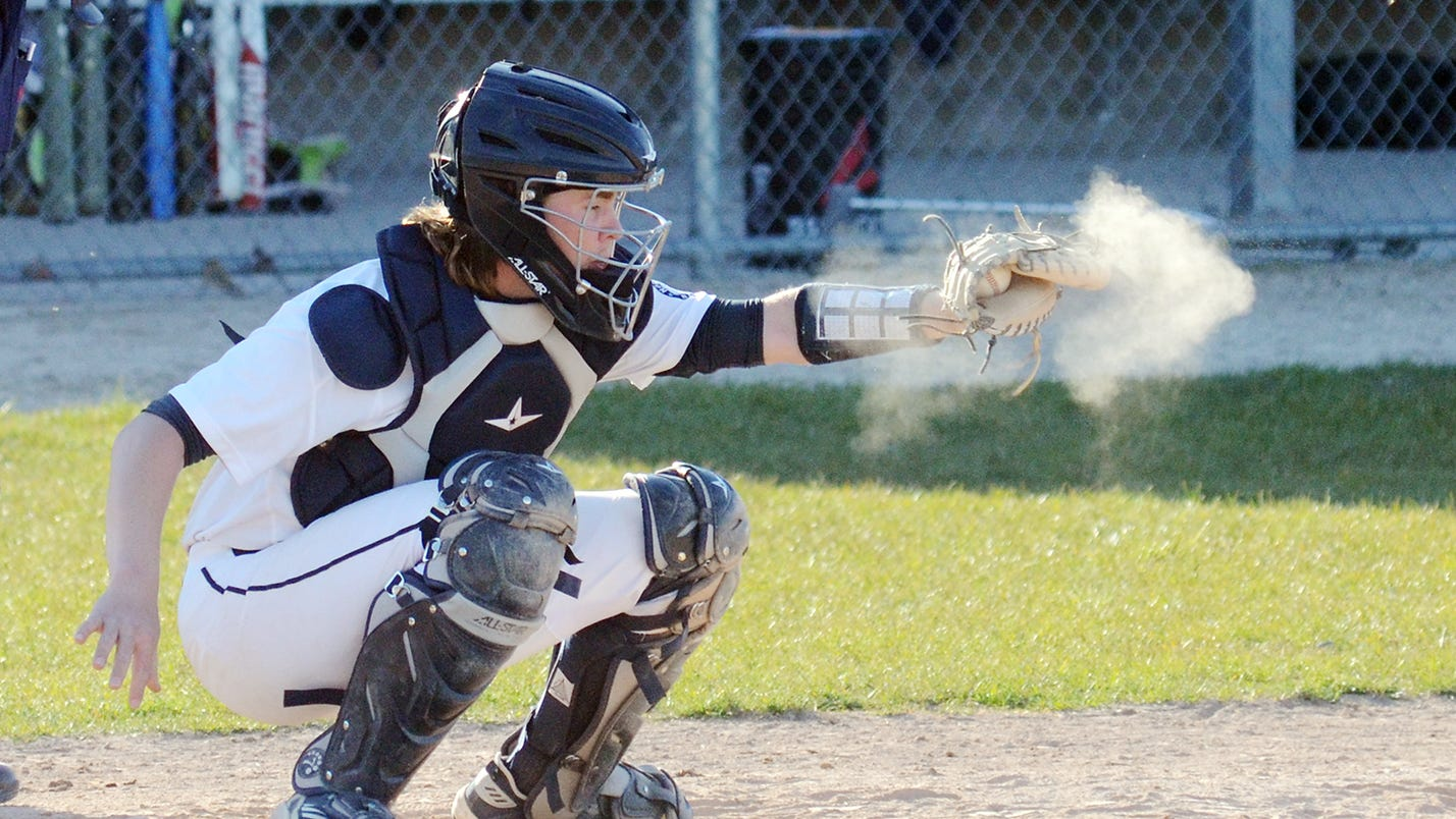 Petoskey receiver Stephen McGeehan strikes his glove during the second game against the Big Rapids.