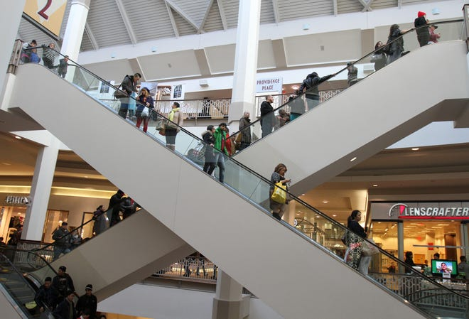 """Shoppers fill Providence Place on """"Black Friday"""" in 2013. Like most malls, Providence Place has been hit hard by the COVID-19 pandemic. Its owner is seeking mortgage relief."""