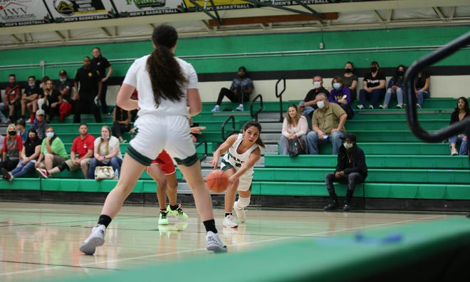 Lady Burro Letty Sepulveda makes a desperate pass during the final minutes of Monday night's game against Oak Hills.