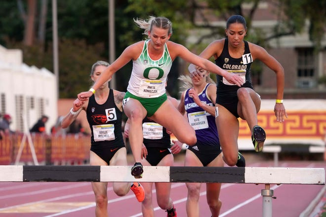 Aneta Konieczek hurdles a barrier in the women's steeplechase en route to her first-place finish during the Pac-12 Championships on May 15 in Los Angeles.