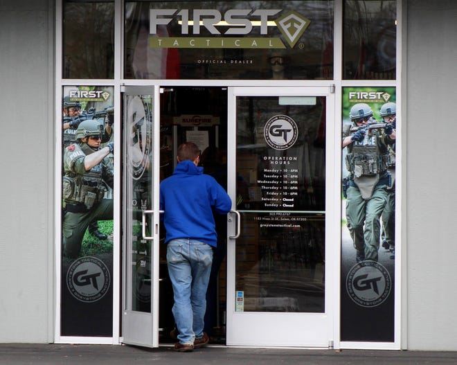 """A man enters a gun shop in Salem, Feb. 19.  A """"Second Amendment Sanctuary"""" measure narrowly approved last year by Columbia County voters  bans local officials from enforcing most federal and state gun laws."""