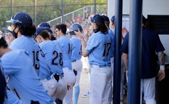 Out-of-Door Academy players cheer from the dugout Saturday during the Thunder's win over Bishop McLaughlin in the Class 2A-Region 3 final. ODA won 4-1 to advance to the Class 2A State Final 4.
