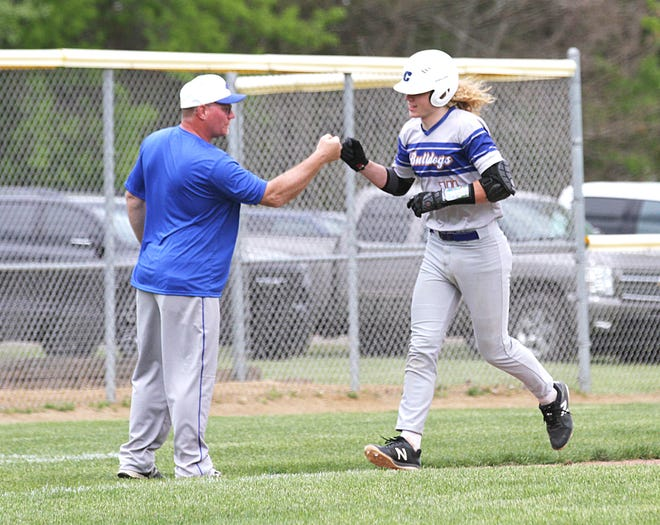 Centreville coach Jeff Spencer fist-bumps Jacob Spencer following his home run in the second game of a sweep over Union City on Saturday.
