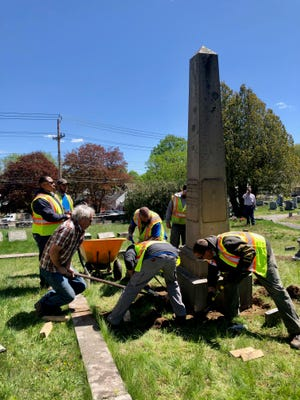 Norwich Public Works employees take part in a gravestone preservation training workshop in Yantic Cemetery in May 2021.