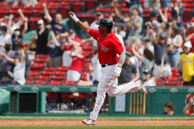 Boston Red Sox's Rafael Devers rounds the bases on his three-run home run during the fifth inning of Sunday's game against the Los Angeles Angels in Boston.