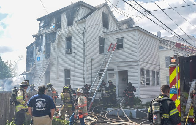 Crews work a fire scene on Mt. Pleasant Avenue in Leominster on Saturday afternoon. Two people were injured in the three-alarm blaze.