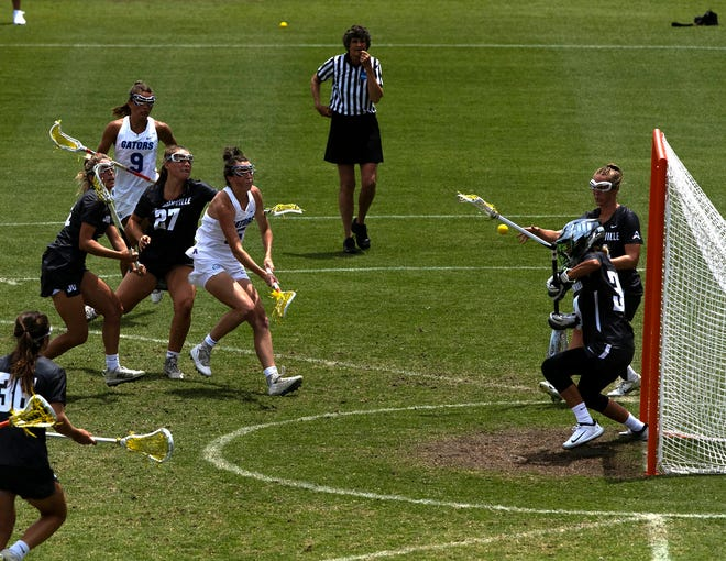 Florida attack Grace Haus (15) scores a goal against Jacksonville in first half action in the NCAA women's lacrosse tournament.