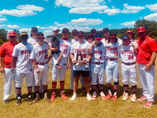 The Burlington School baseball team poses with the NCISAA Class 2-A state runner-up trophy after losing to Wayne Country Day 15-1 in Game 2 of the best-of-3 series Saturday.