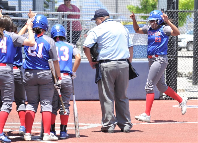 Cooper's Jennika Willis, right, celebrates as she approaches home plate after hitting a two-run homer in the fourth inning against El Paso Hanks. Cooper won 15-8 to sweep the best-of-three Region I-5A quarterfinal series Saturday in Fort Stockton.