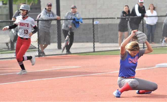Cooper pitcher Jahlissah Marquez falls to the turf after getting the final out in the Lady Cougars' 15-8 victory over El Paso Hanks to sweep the best-of-three Region I-5A quarterfinal series Saturday in Fort Stockton.