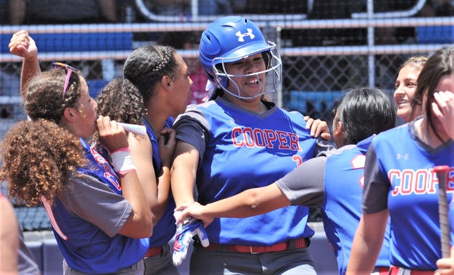 Cooper players congratulate Kaleigha Kemp, center, after Kemp hit her first of two homers in the game. Kemp led the Lady Cougar offense to earn ARN Local Player of the Week honors.