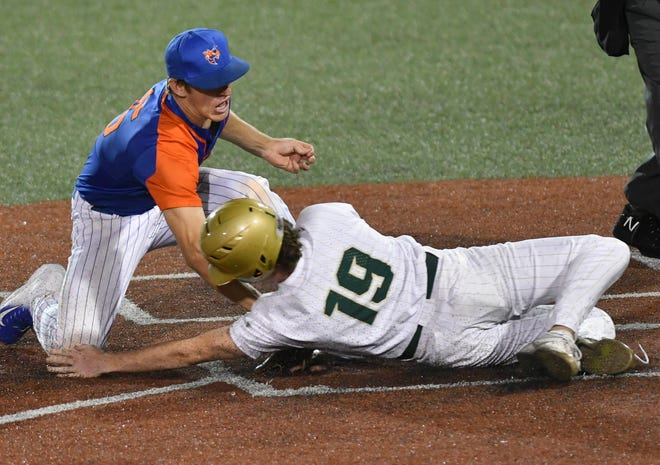 Bartow pitcher Robby Putnam tags out Viera's Tommy Collins at the plate during Saturday's Regional Final at USSSA Space Coast Stadium. Craig Bailey/FLORIDA TODAY via USA TODAY NETWORK