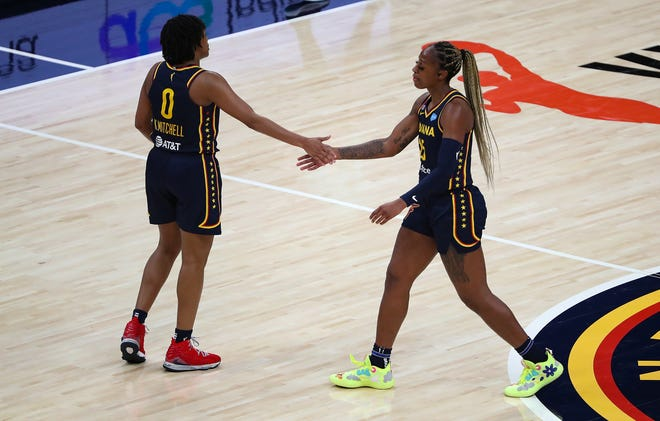 Indiana Fever guard Kelsey Mitchell (0) and guard Tiffany Mitchell (25) tap hands during the fourth quarter of the home opener Sunday, May 16, 2021, at Bankers Life Fieldhouse in Indianapolis. The Fever lost, 73-65.